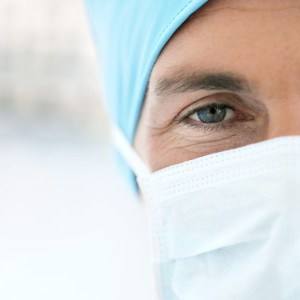 Young Male Doctor Wearing Protective Headgear and Face Mask